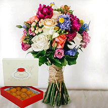 Mesmerizing Flowers and Motichoor Laddoo Combo: Anniversary Flowers and Sweets
