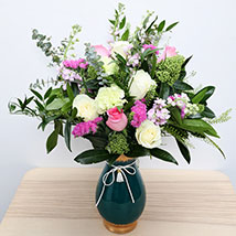 Roses N Carnations in Glass Vase: Women's Day Gifts