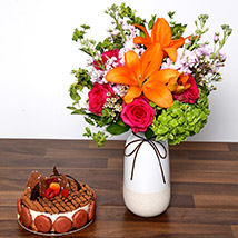 Vivid Mixed Flower Vase and Cake: Cake and Flower Delivery in Dubai
